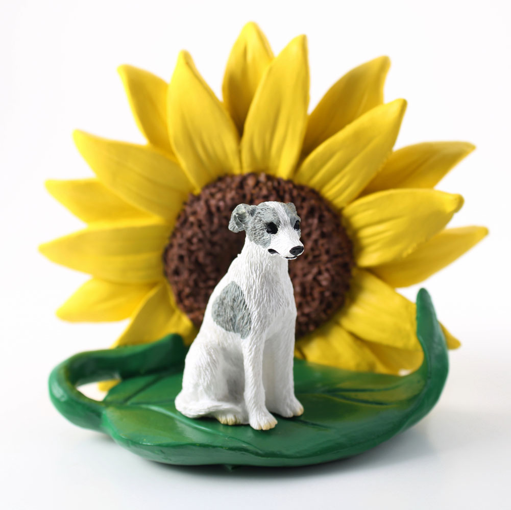 Whippet Gray Figurine Sitting on a Green Leaf in front of a Yellow Sunflower
