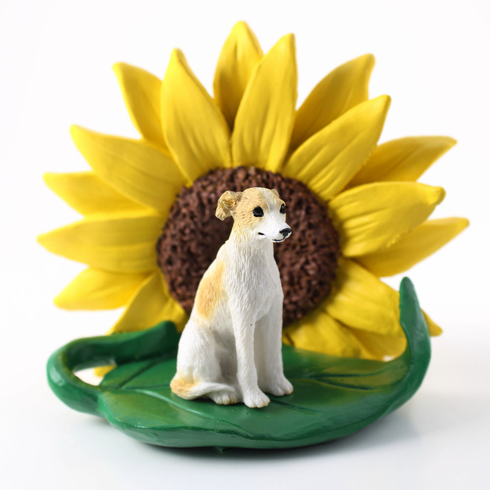Whippet Tan Figurine Sitting on a Green Leaf in front of a Yellow Sunflower