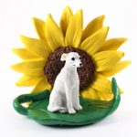 Whippet White Figurine Sitting on a Green Leaf in front of a Yellow Sunflower